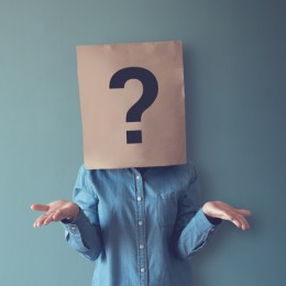 Woman has Confused, Thinking, Question Mark Icon on Paper Bag, copy space.